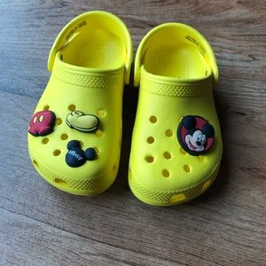 Yellow crocs with Disney accessories